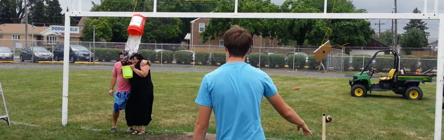 QB+Tom+Pajor+watches+as+his+throw+leads+to+a+doused+Ms.+French+and+Mr.+Schuett.