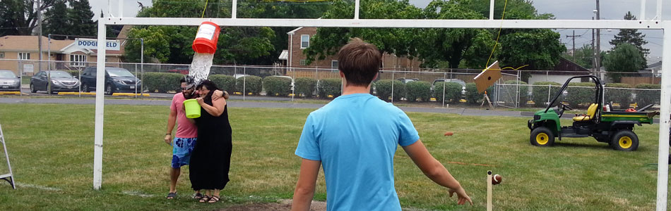 QB Tom Pajor watches as his throw leads to a doused Ms. French and Mr. Schuett.