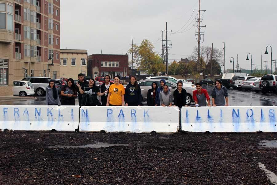 Artists pose after their first (though rained out ) version of the mural.