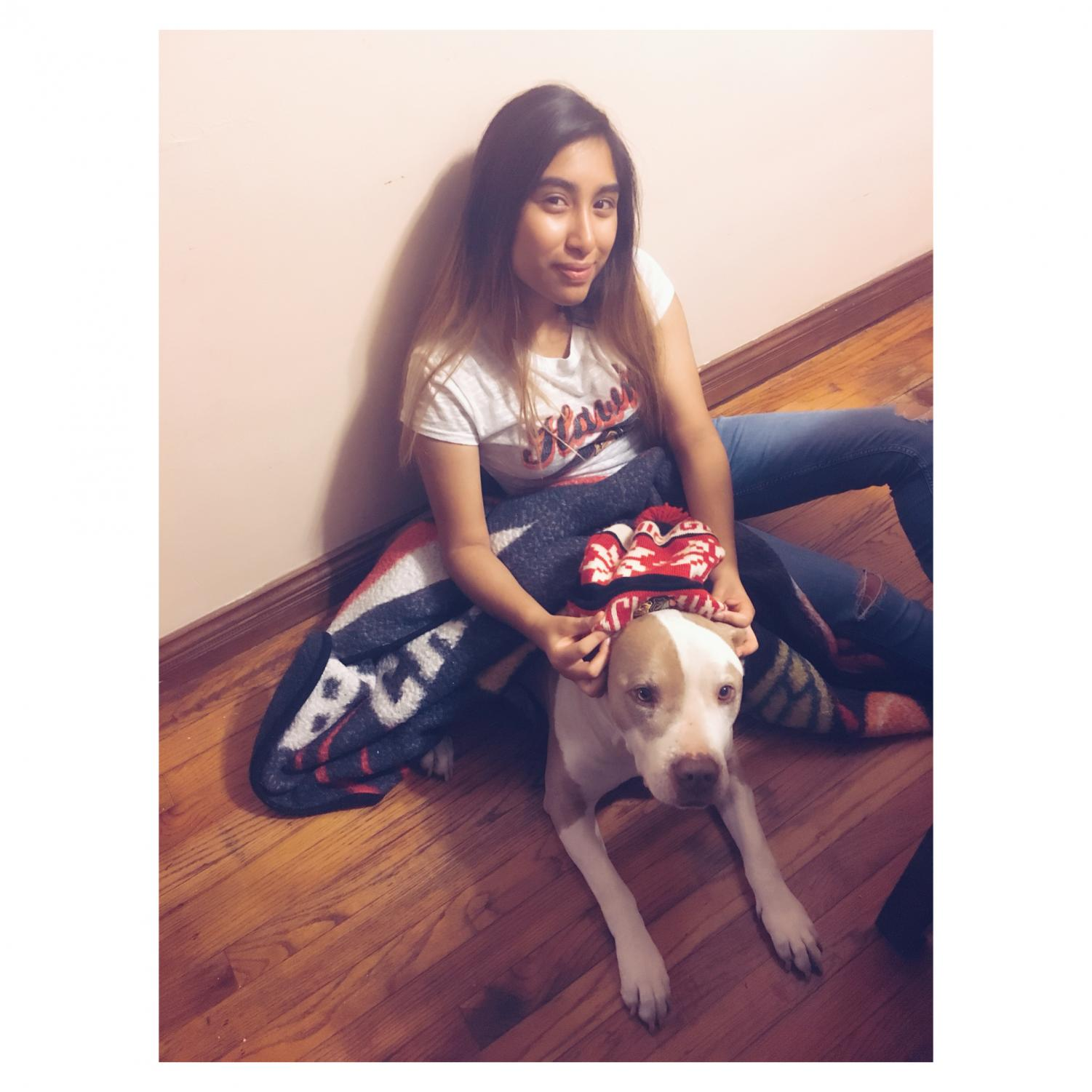 Sandra Castellanos and her dog Koko pose while wearing some Blackhawk gear.